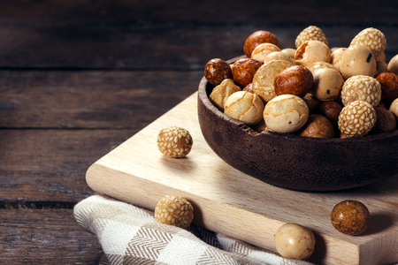 Asian mix with peanuts on the wooden background,selective focus photo