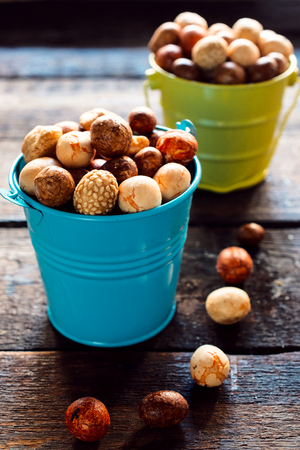 Asian sweet peanuts in the metal baskets,selective focus photo