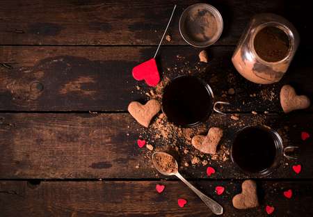 Hot cocoa and cookies on wooden background with blank space