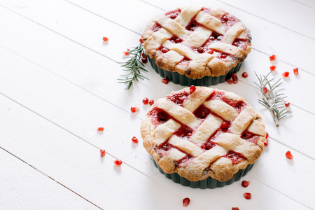 sweet tart: Sweet tart cake stuffed with pomegranate jam on wooden background with blank space