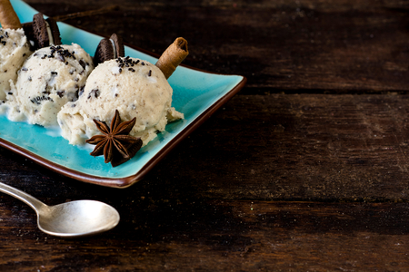 stracciatella: Stracciatella homemade ice cream and cookies on wooden background with blank space Stock Photo