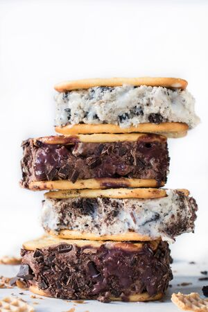 Stack of ice cream sandwiches on white background Stock Photo