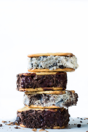 stracciatella: Chocolate and  stracciatella ice creams sandwiches on white background Stock Photo