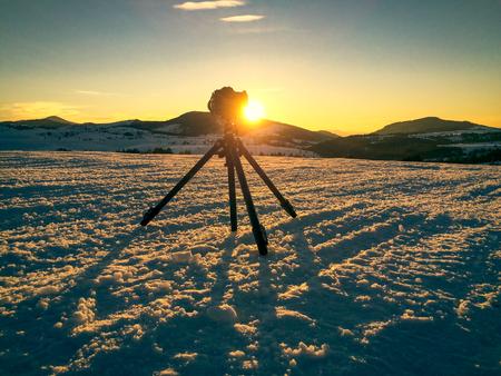 mountin: Camera on tripod shooting mountin landscape in sunset Stock Photo