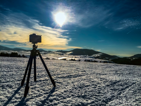 mountin: Camera on tripod shooting mountin landscape in winter time