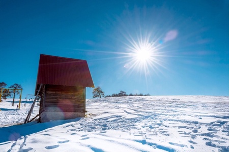Stron sun over mountain landscape in the winter time photo
