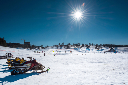 Ski resort in the winter time on sunny day photo