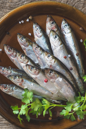 freisteller: Small fishes called smelt in the plate Stock Photo