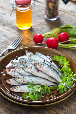 sprat: Selective focus on the front smelt fishes in plate Stock Photo