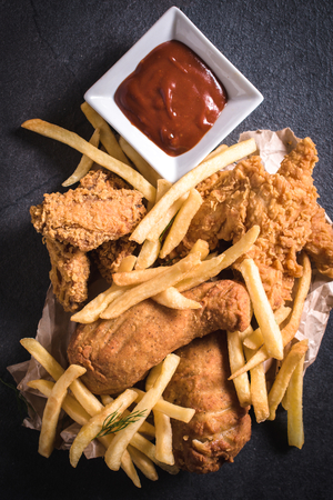 american cuisine: Traditional American cuisine,fried chicken meat and French fries