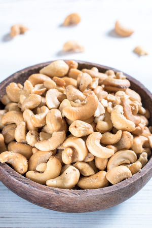 noone: Cashew nuts in the wooden bowl,selective focus