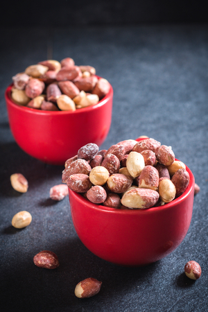 earthnuts: Fried peanuts in the coffee cups,selective focus Stock Photo