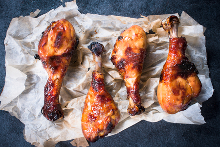 proficient: Four fried chicken legs with honey and spices,selective focus