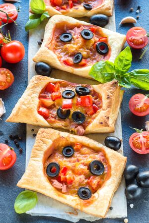 mini pizza: Mini pizza with ham and vegetables,selectve focus in the middle
