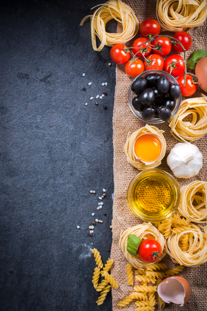 Blank dark board with cooking ingredients from above Stock Photo