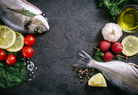 overfishing: Glithead fishe with ingredients and blank space in the middle Stock Photo