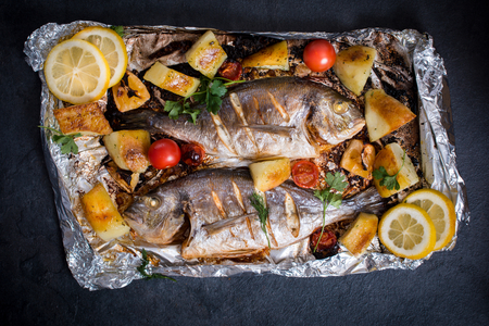 gilthead: Prepared and grilled gilthead fish with vegetables and potatoes from above