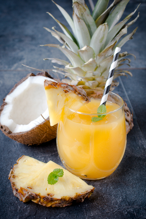 Ananas juice in the glass,selective focus Stock Photo