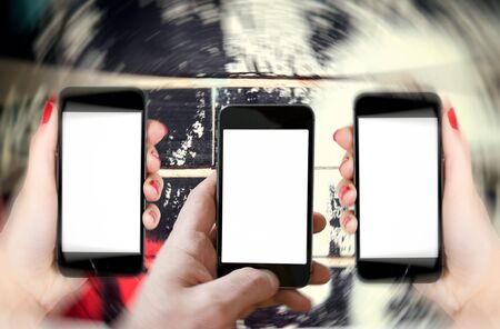 blurr: Man holding phone with blank screen and blurred motion of side phones