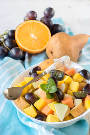 fruity salad: Healthy salad with tropical and domestic fruit in the bowl,selective focus