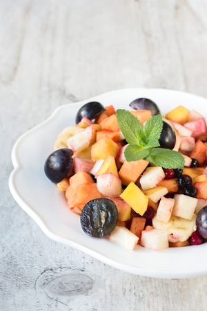 fruity salad: Healthy sweet fruit salad with different kind of tropical fruits,selective focus