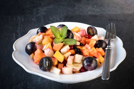 fruity salad: Fresh fruit salad in the plate,selective focus Stock Photo