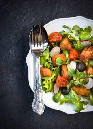 redish: Fresh chicken salad with vegetables in the plate Stock Photo