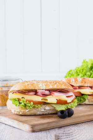 Ciabatta sandwich with bacon and cheese from above,selective focus and blank space photo