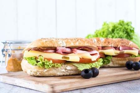 Ciabatta sandwich with bacon and cheese on wooden boarde,selective focus and blank space photo