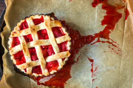 sweet tart: Sweet tart cake with strawberries sauce on baking paper,selective focus