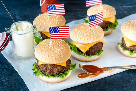 American mini beef burgers with cheese and USA flags,selective focus