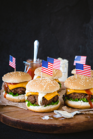 ground beef: Mini ground beef burgers with American flag on wooden backgound,selective focus Stock Photo