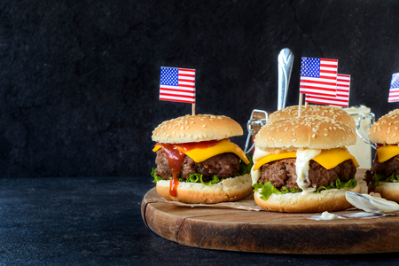 independence day: Greound beef mini burgers on wooden board,selective focus and blank space