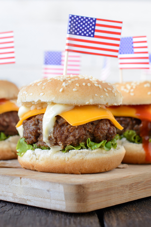 vertica: Close up to beef mini beef burger with American flag on top,selective focus Stock Photo