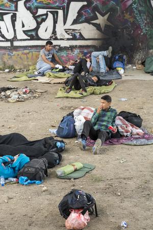 homeless children: BELGRADE,SERBIA -JUNE 30, 2015: unidentified Syrian refugees, under the bridge,waithing for transport in Europian Union June 30, 2015 in Belgrade,Serbia Editorial