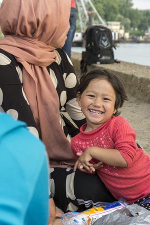 syrian civil war: BELGRADE,SERBIA -JUNE 30, 2015: unidentified Syrian refugees, under the bridge,waithing for transport in Europian Union June 30, 2015 in Belgrade,Serbia Editorial