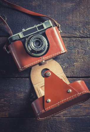 backgound: Old film camera on wooden backgound
