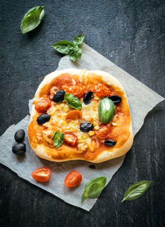 mini pizza: Vegetarian mini pizza served on dark background