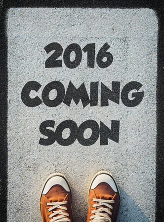 on coming: Brand new red shoes from above standing on 2016 coming soon sign