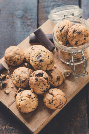 chocolate chip cookies: Mini homemade chocolate chip cookies on wooden background, selective focus Stock Photo