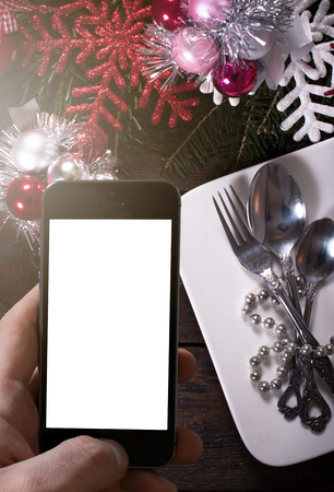 decoraton: Wooden background with blank screen on phone and Christmas decoraton Stock Photo