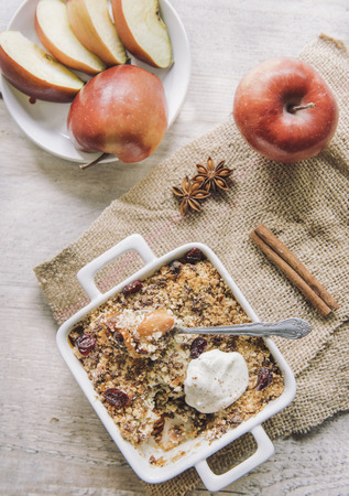 apple crumble: Homemade sweet apple crumble cake from above on wooden background Stock Photo