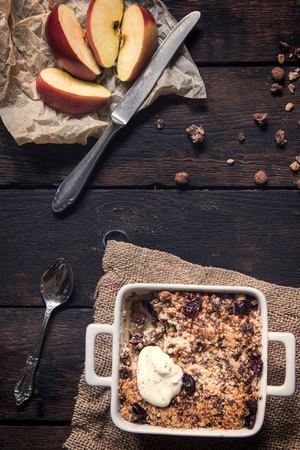 apple crumble: Homemade sweet apple crumble cake from above on dark wooden background Stock Photo