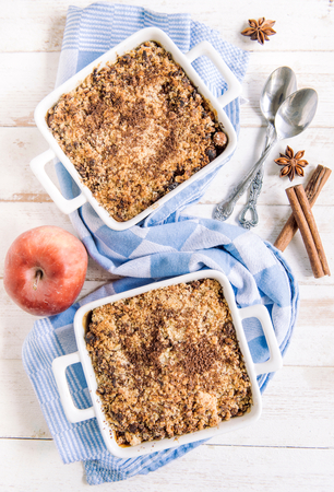 apple crumble: Homemade sweet apple crumble cake from above on white wooden background Stock Photo