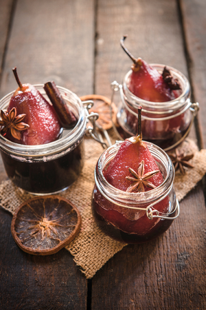 red cooked: Pears cooked in the red wine served in jars,selective focus