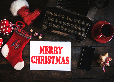 Merry Christmas concept on wooden background