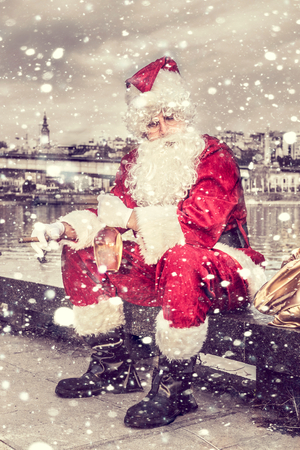 drunk: Sad Santa Claus with cigar and bottle of brandy outdoor Stock Photo