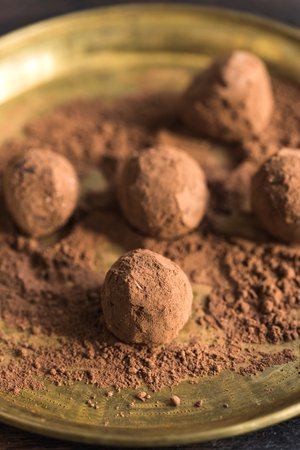pralines: Homemade sweet cocoa pralines in the plate,selective focus Stock Photo