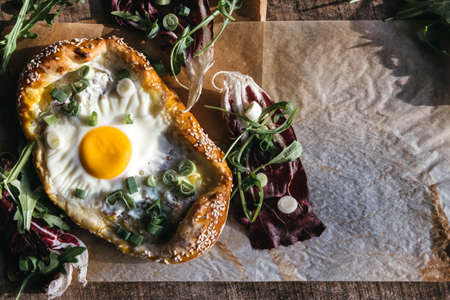 mini pizza: Served mini pizza with fried egg on wooden background with blank space Stock Photo