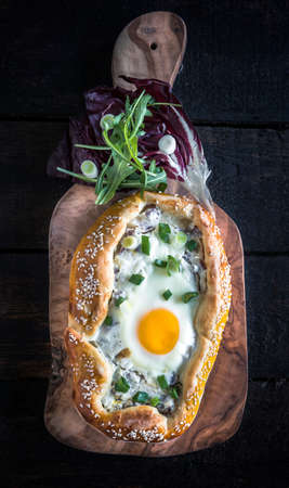 mini pizza: Homemade mini pizza with fried egg and onions Stock Photo